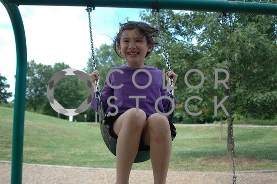 Girl swinging at the playground - Colorstock™  © Anna-Rhesa Versola  - diverse stock photos