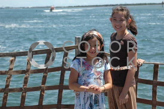 Girls on the pier - Colorstock™  © Anna-Rhesa Versola  - diverse stock photos
