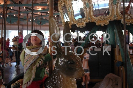 Girl on a merry-go-round - Colorstock™  © Anna-Rhesa Versola  - diverse stock photos