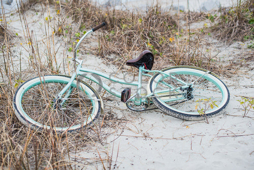 Blue bike at the beach - Colorstock™  © Sirena White  - diverse stock photos
