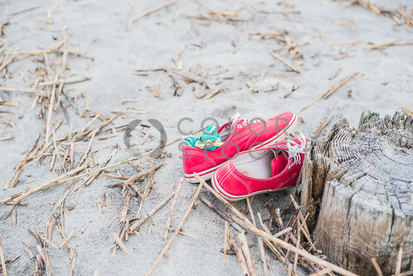 Red shoes at the beach - Colorstock™  © Sirena White  - diverse stock photos