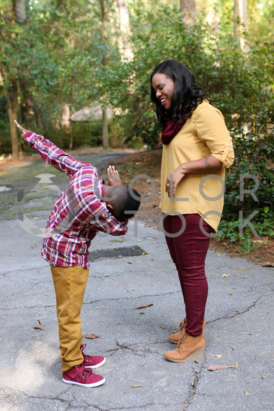 Kid Dancing in front of her mom, Lavish Moments Photography - Colorstock: diverse stock photos