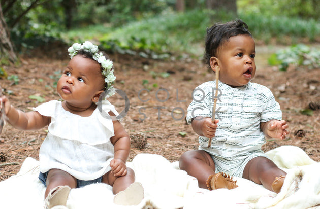 Twins - babies sitting in the park, Lavish Moments Photography - Colorstock: diverse stock photos