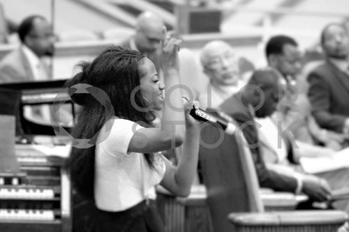 Young woman singing a solo in church choir - Colorstock™  © Bereket Kelile  - diverse stock photos