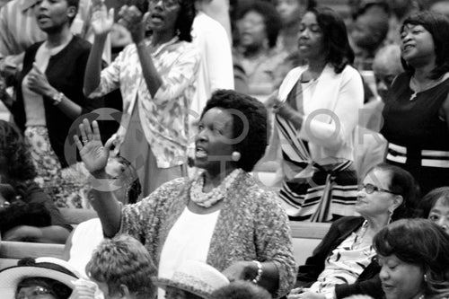 Woman singing in church congregation - Colorstock™  © Bereket Kelile  - diverse stock photos