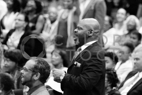 Man in congregation singing in church - Colorstock™  © Bereket Kelile  - diverse stock photos