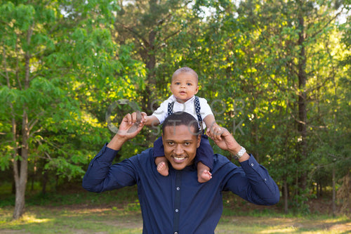Baby on father's shoulders - Colorstock™  © Jennifer Hogan  - diverse stock photos
