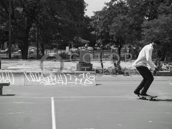Skateboarder in city park - B&W - Colorstock™  © Jenifer Daniels  - diverse stock photos