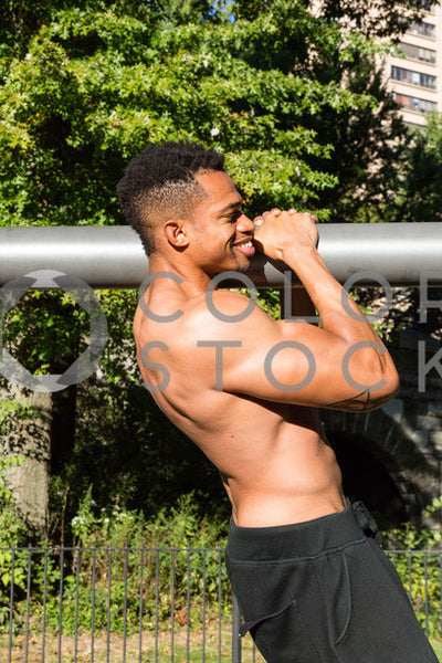 Close up of man doing a pull-up, Click Clique NYC - Colorstock: diverse stock photos