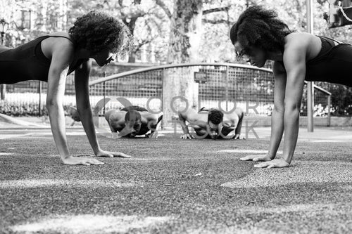 Fitness crew doing push-ups at city park - 2