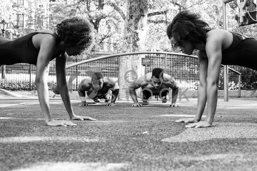 Fitness crew doing push-ups at city park - 3