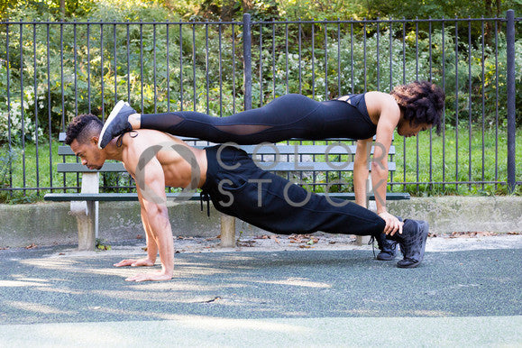 Man and woman doing push-ups, Click Clique NYC - Colorstock: diverse stock photos