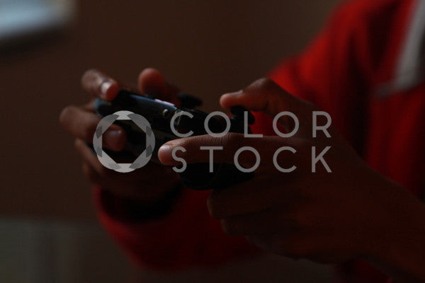 Boy playing video games, Zoe Moore - Colorstock: diverse stock photos