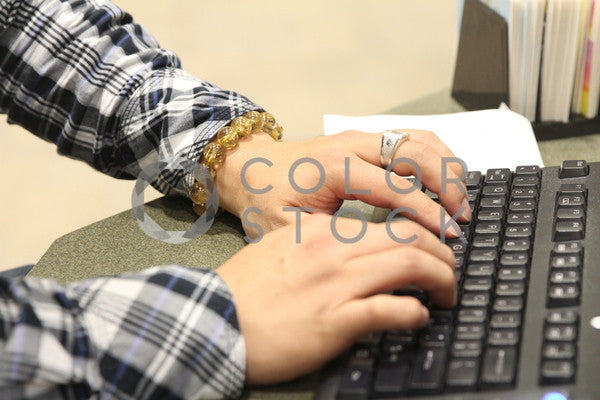 Man typing on computer