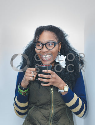 Woman laughing while drinking from a mug, Brandon Nesbitt - Colorstock: diverse stock photos