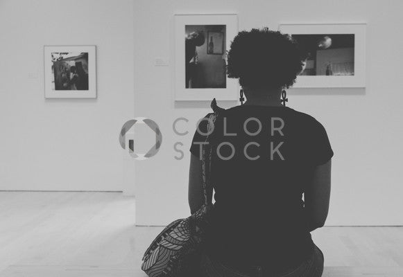 Woman sitting in art gallery