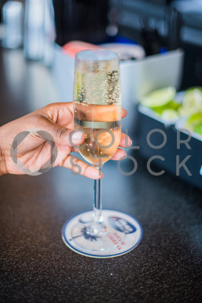 Champagne at the bar - Colorstock™  © Sirena White  - diverse stock photos