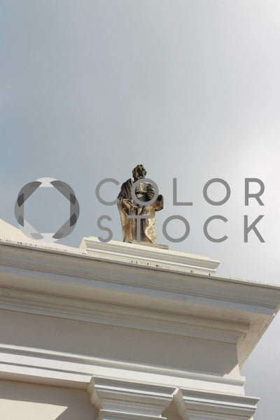 Statue on top of old building - Colorstock™  © Janan Graham-Russell  - diverse stock photos