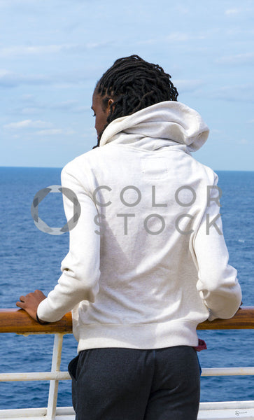 Man on cruise looking out on balcony, Stephanie Warren - Colorstock: diverse stock photos