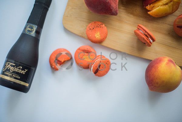 Peach macaroons and champagne - Colorstock™  © Sirena White  - diverse stock photos