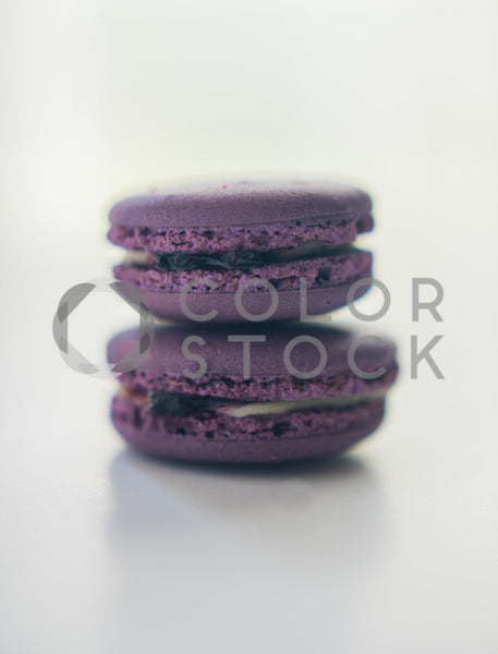 Two purple macaroons - Colorstock™  © Sirena White  - diverse stock photos