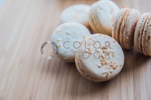 Cream macarons on a cutting board