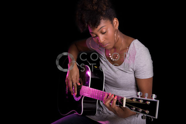 Young woman playing the guitar - Colorstock™  © Jennifer Hogan  - diverse stock photos