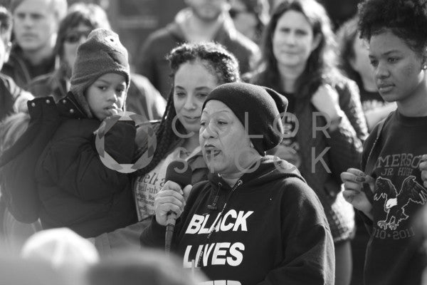 Older woman speaking at peaceful rally - B&W