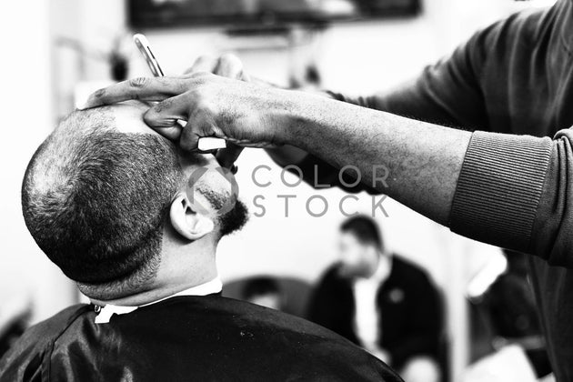 Man getting his hair cut at the barber shop, Dream Free Photography - Colorstock: diverse stock photos