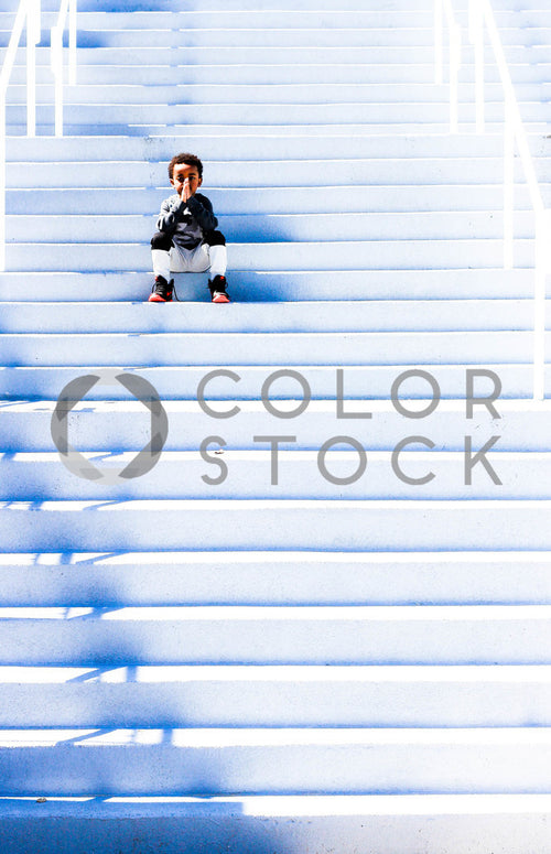 Child sitting on the stairs
