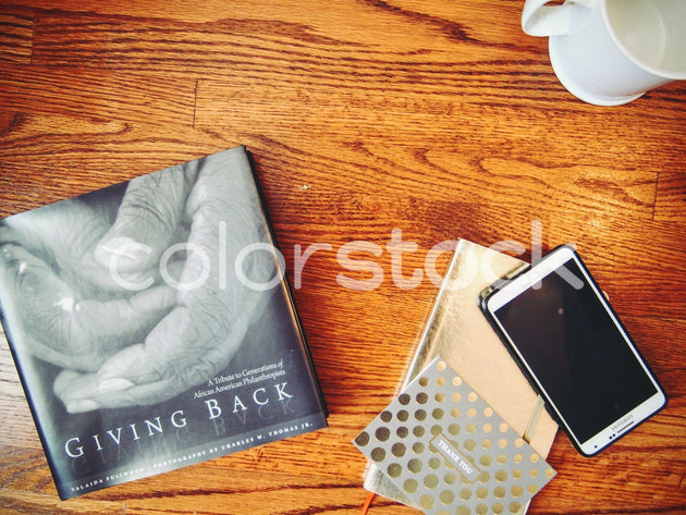 Book on desktop with smartphone - Colorstock™  © Jenifer Daniels  - diverse stock photos
