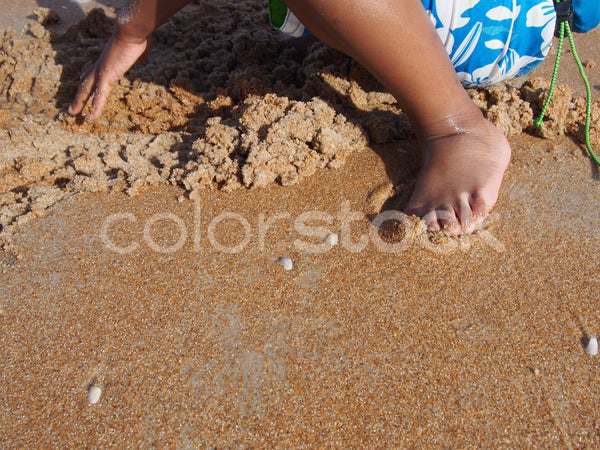 Boy playing in the sand at the beach - Colorstock™  © Jenifer Daniels  - diverse stock photos