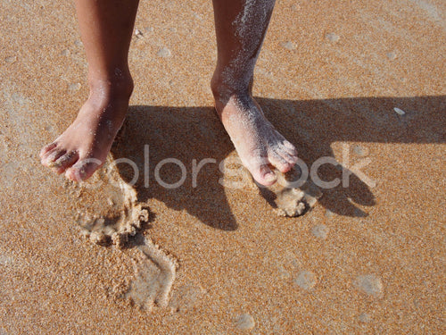 Boy's toes in the sand at beach - Colorstock™  © Jenifer Daniels  - diverse stock photos