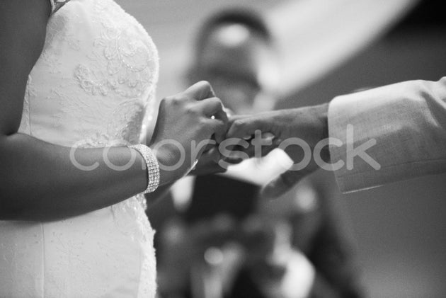 Bride placing the ring on groom's hand - Colorstock™  © Integrative Flash  - diverse stock photos