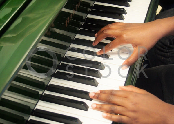 Child playing the piano - Colorstock™  © Jenifer Daniels  - diverse stock photos