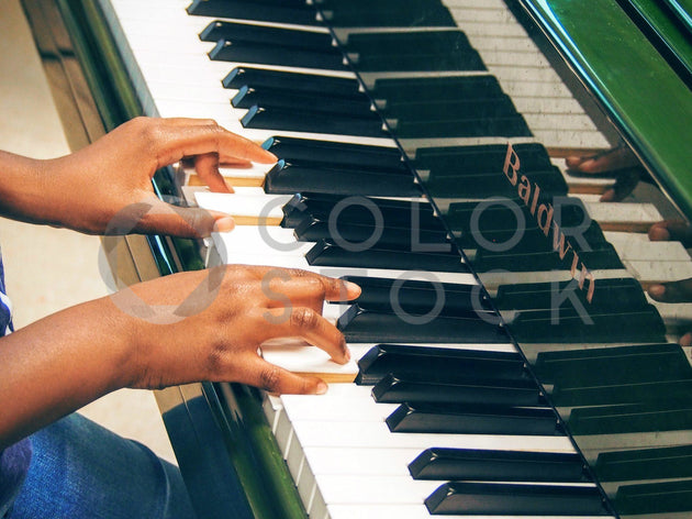 Child playing the piano (up close) - Colorstock™  © Jenifer Daniels  - diverse stock photos