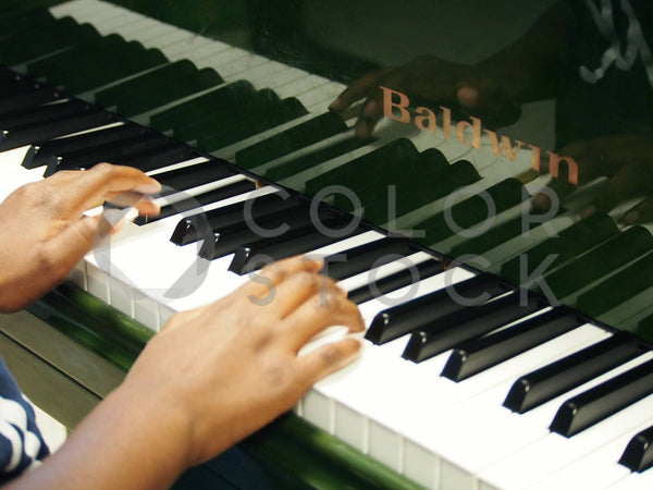 Child's fingers on the piano - Colorstock™  © Jenifer Daniels  - diverse stock photos