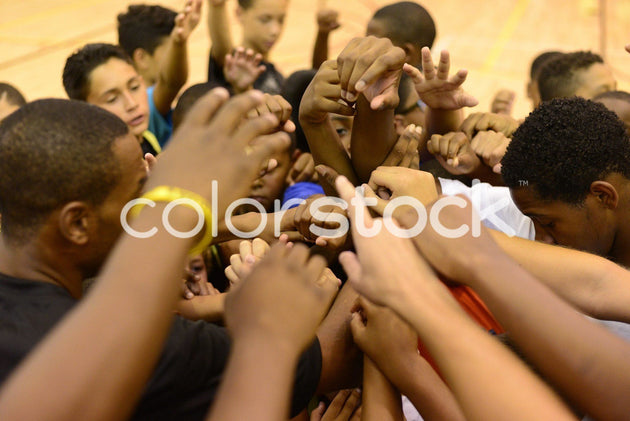 Children's hands in a sports group cheer - Colorstock™  © PorterhouseLA  - diverse stock photos