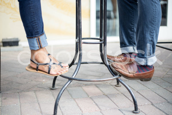 Close-up view of man and woman jeans and shoes - Colorstock™  © Shea Parikh  - diverse stock photos