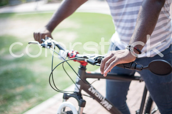 Close up view of man on bike - Colorstock™  © Shea Parikh  - diverse stock photos