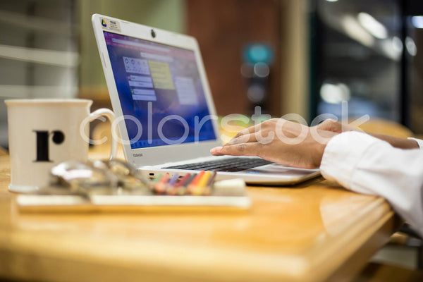 Close-up view of woman typing - Colorstock™  © Shea Parikh  - diverse stock photos