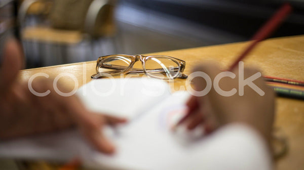 Close view of glasses on table - Colorstock™  © Shea Parikh  - diverse stock photos