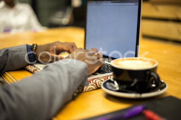 Coffee and a laptop - Colorstock™  © Shea Parikh  - diverse stock photos