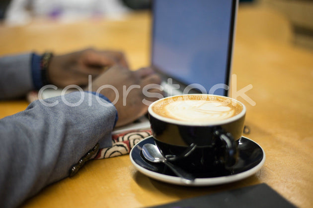 Coffee, laptop and work - Colorstock™  © Shea Parikh  - diverse stock photos