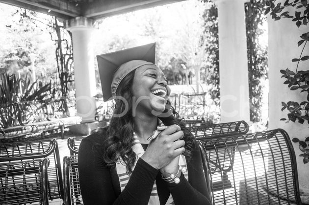 College graduate laughing - Colorstock™  © Integrative Flash  - diverse stock photos