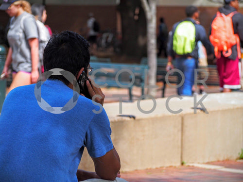 College student on his smartphone - Colorstock™  © Jenifer Daniels  - diverse stock photos