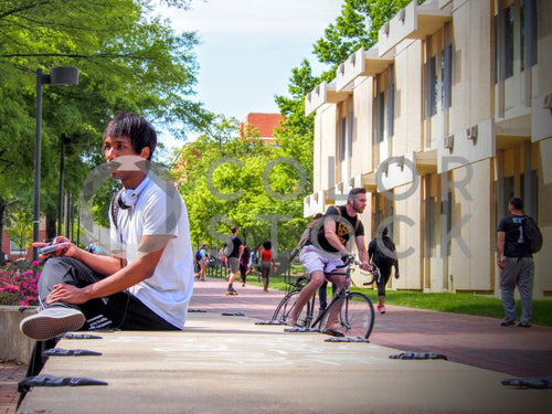 College student sitting on campus - Colorstock™  © Jenifer Daniels  - diverse stock photos
