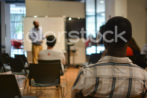 Conference attendees listening to speaker - Colorstock™  © Aurelius Creates  - diverse stock photos