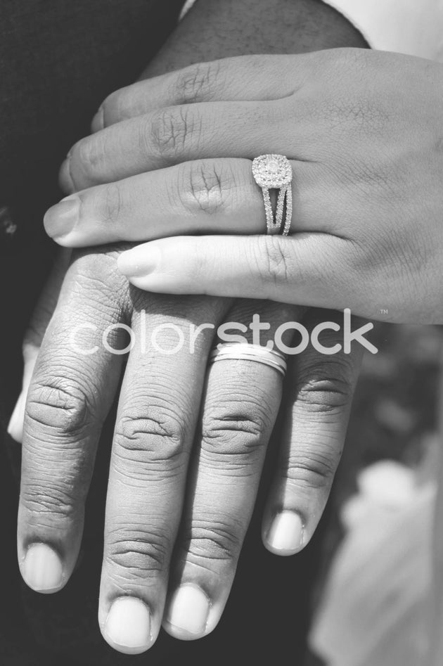 Couple showing their wedding rings - Colorstock™  © Casha Dees  - diverse stock photos