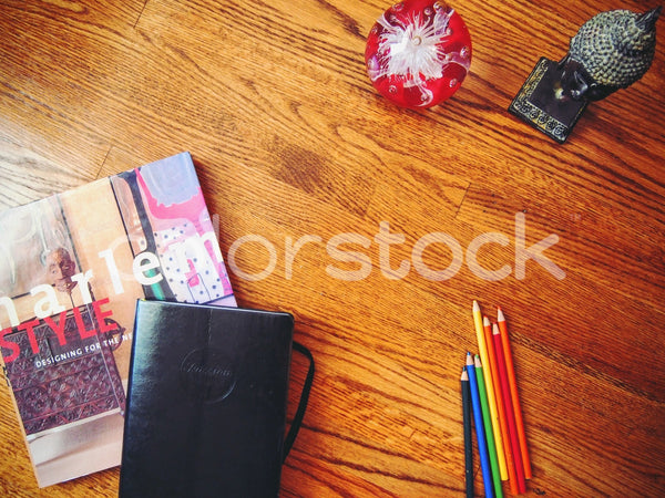 Decorating book with sketchbook and pencils on desk - Colorstock™  © Jenifer Daniels  - diverse stock photos